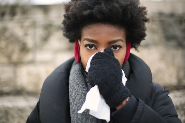 Beautiful afro woman caught a cold