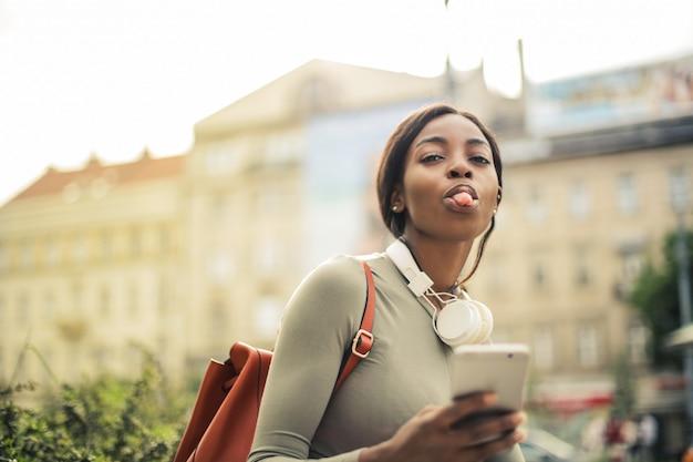 Beautiful afro woman showing her tongue