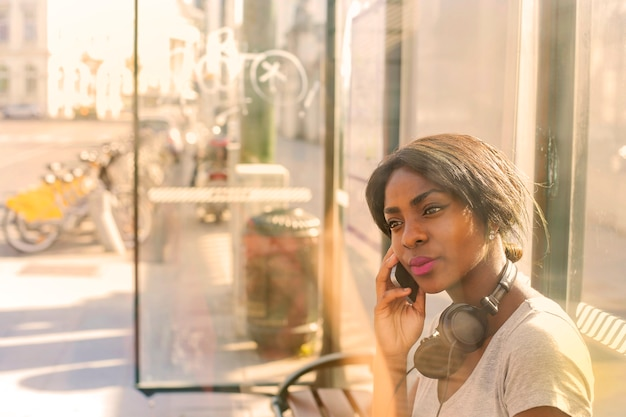 Beautiful afro woman talking on a smartphone