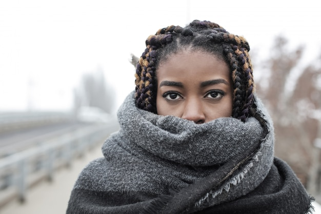 Beautiful afro woman wrapped in a scarf