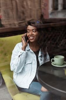 Beautiful afroamerican woman talking on phone