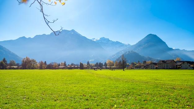 Beautiful of alps mountain and village at autumn in interlaken canton, switzerland