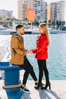 Beautiful amorous couple on waterfront
