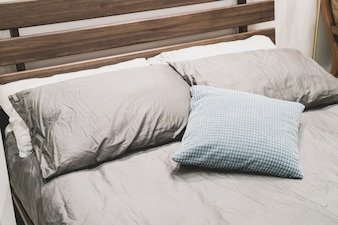 Beautiful and comfortable pillow decoration on bed