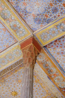 Beautiful antique wooden pillar and ceiling at the entrance of ancient persian chehel sotun.