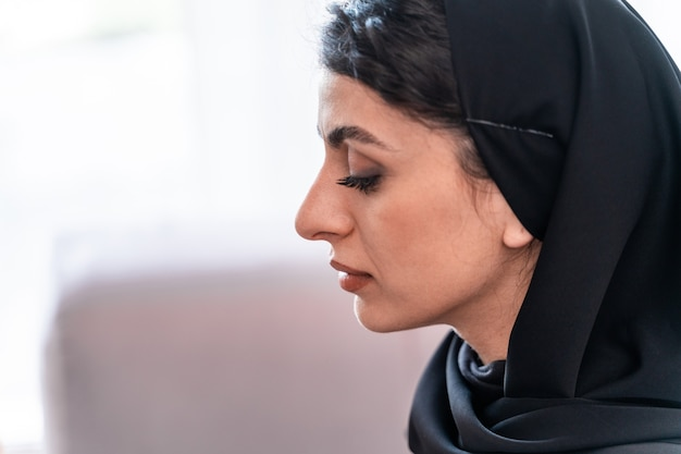 Beautiful arabian woman studying koran book