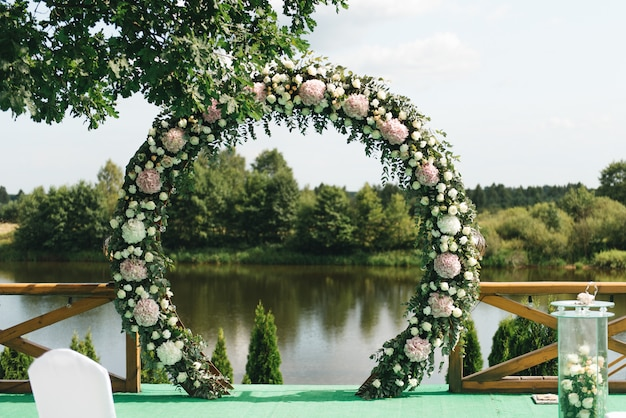 Beautiful arch for wedding ceremony, on natural landscape with lake views