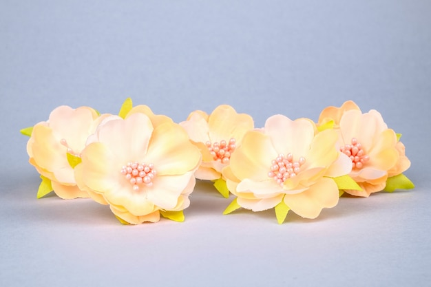 Beautiful artificial flowers on colourful background