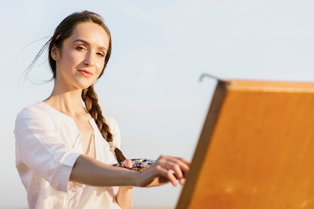Beautiful artistic woman painting