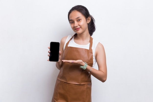 Beautiful asian barista waitress demonstrating mobile cell phone on white background