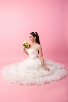 Beautiful asian bride portrait in pink studio