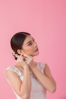 Beautiful asian bride portrait in pink