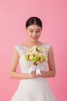 Beautiful asian bride portrait in pink
