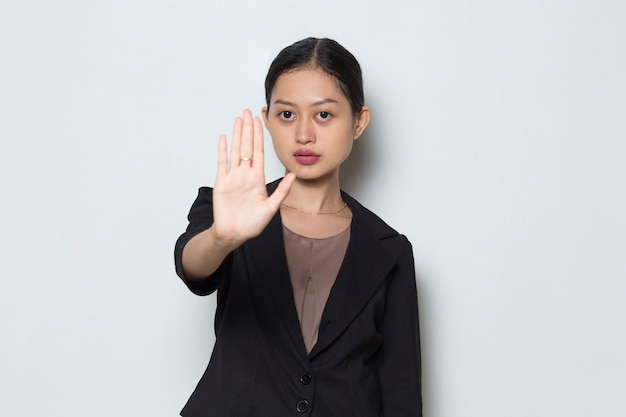 Beautiful asian business woman making stop gesture with her hand