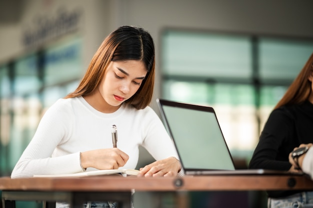 Beautiful asian female student sit for exam at university classroom students sitting in the row education lifestyle university college