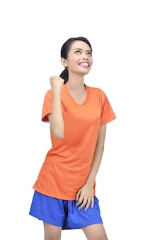 Beautiful asian football player woman in orange jersey with happy expression