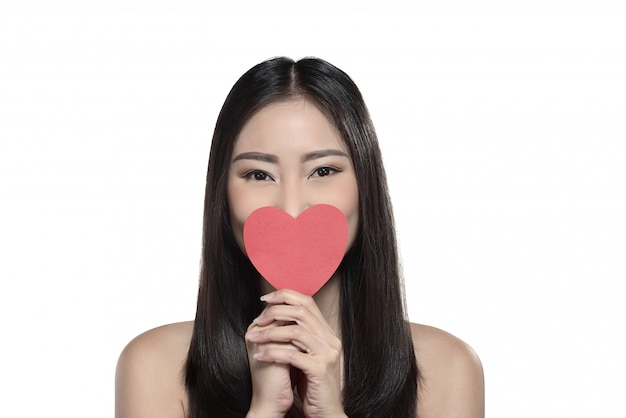Beautiful asian girl holding red heart