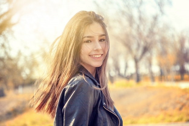 Beautiful asian girl teenager schoolgirl, autumn portrait, joy happiness fun emotions