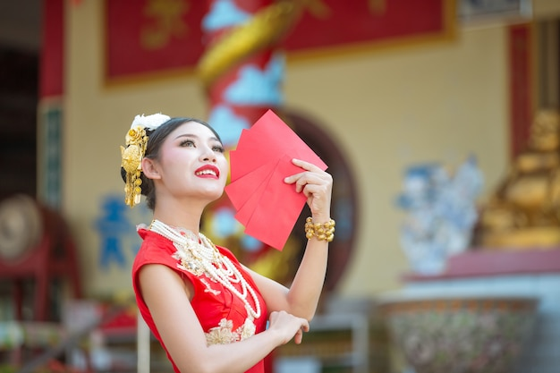 A beautiful asian girl wearing a red dress