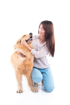 Beautiful asian girl with golden retriever dog isolated over white background