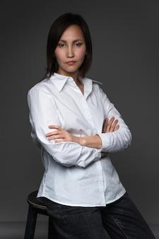 Beautiful asian model  wearing oversize white shirt posing