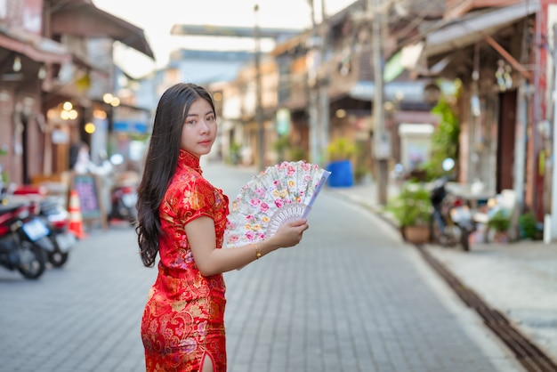 Beautiful asian model wearing traditional cheongsam.happy chinese new year