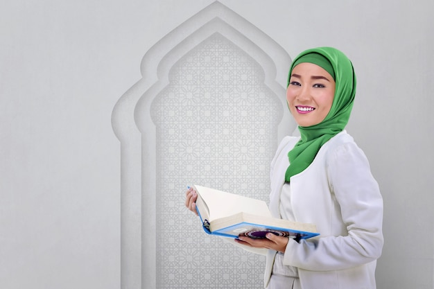 Beautiful asian muslim woman read the koran