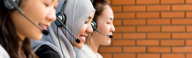 Beautiful asian muslim woman working in call center with her team