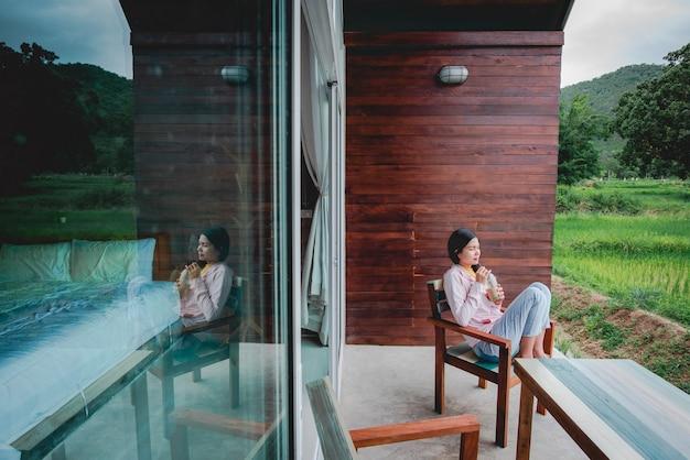 A beautiful asian tourist sits room terrace