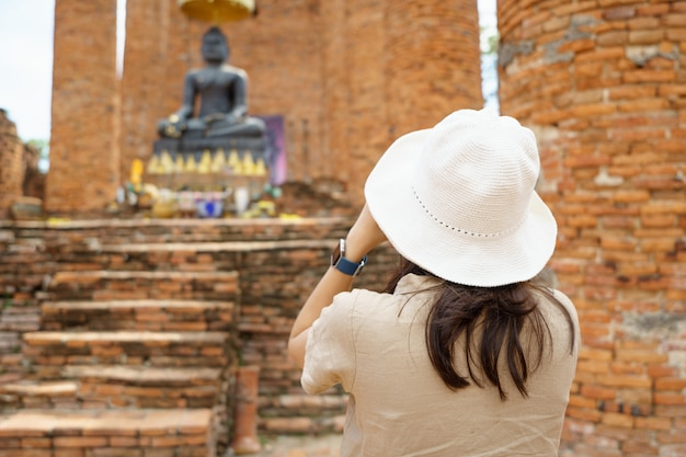 Beautiful asian tourists walking, taking photos and traveling on holidays the old town,