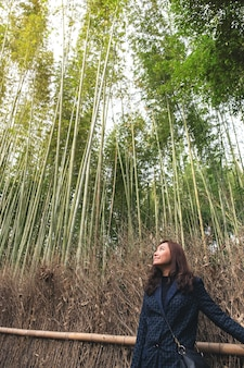 A beautiful asian woman in bamboo forest