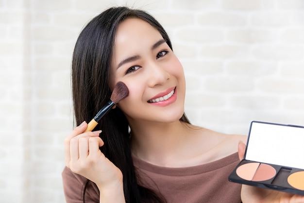 Beautiful asian woman beauty blogger doing cosmetic makeup tutorial