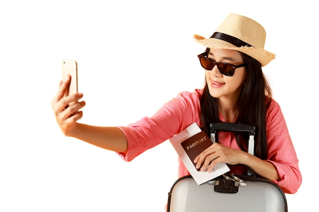 Beautiful asian woman cheerful smiling and take selfie on smart mobile phone,
