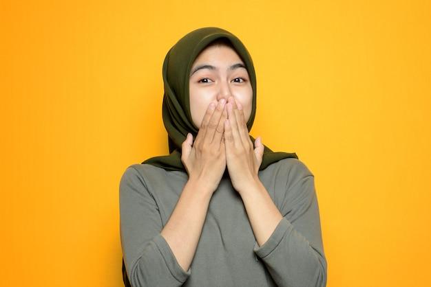 Beautiful asian woman covering mouth