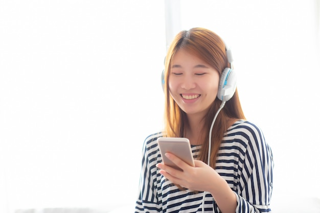 Beautiful asian woman enjoy listen music with headphone