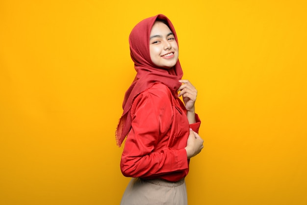 Beautiful asian woman excited on yellow background
