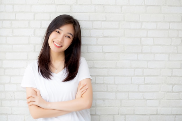 Beautiful asian woman happiness standing on gray cement texture background