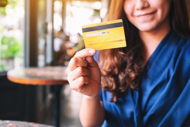 A beautiful asian woman holding credit card for shopping