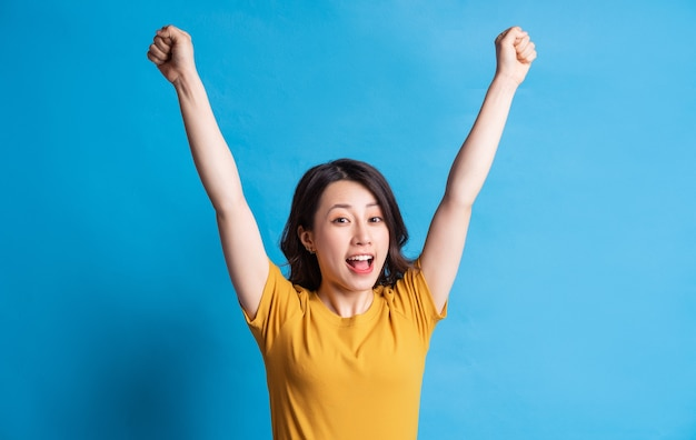 The beautiful asian woman is showing a feeling of victory
