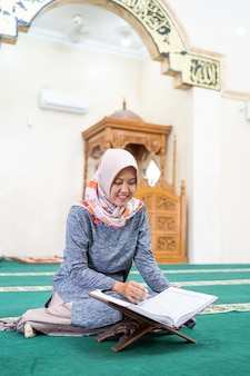 Beautiful asian woman read quran
