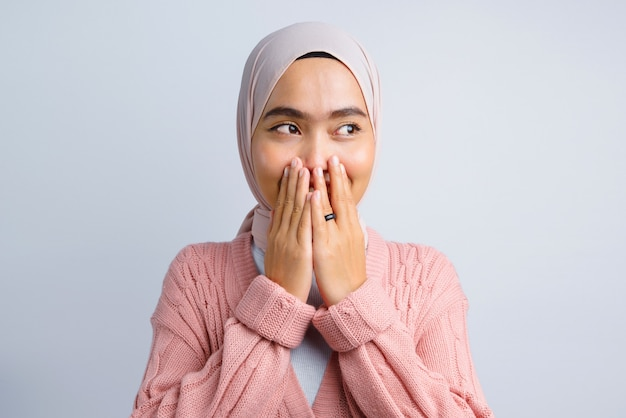 Beautiful asian woman shocked and covering mouth on white