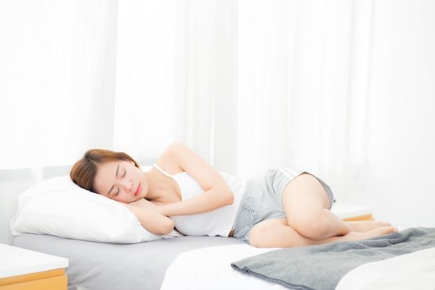 Beautiful asian woman sleeping lying in bed.