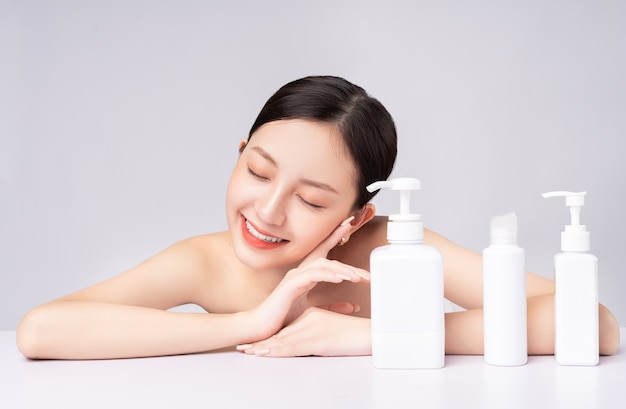 Beautiful asian woman taking care of her skin with natural products