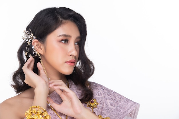 Beautiful asian woman in thai traditional wedding dress with gold accessories