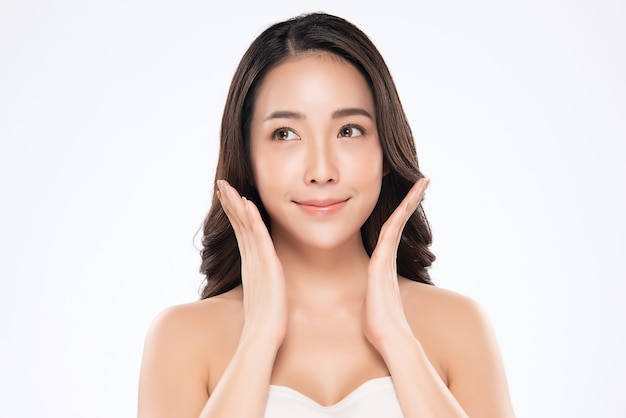 Beautiful asian woman touching soft cheek smile with clean and fresh skin happiness