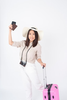 Beautiful asian woman tourist  on white wall