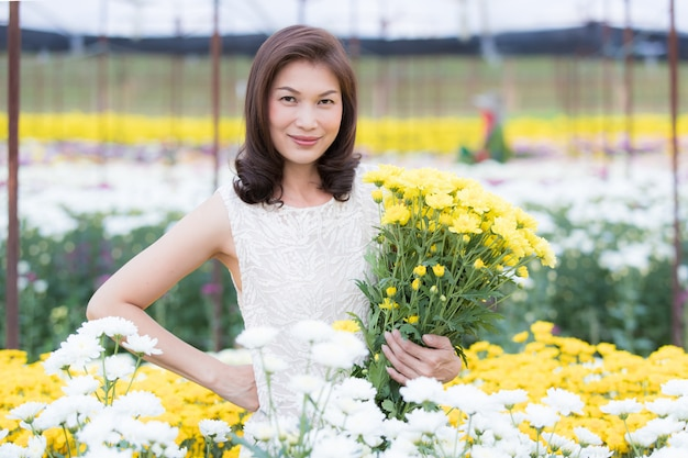 Beautiful asian woman in tropical flower garden