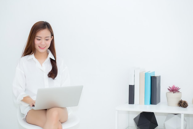 Beautiful asian woman using laptop for leisure on sofa