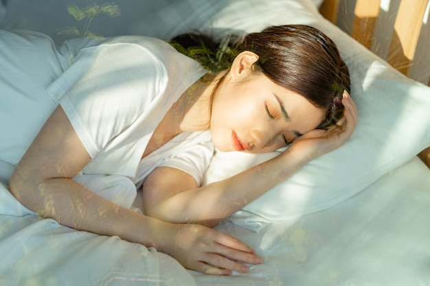 The beautiful asian woman was sleeping past noon