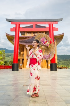 A beautiful asian woman wearing a japanese kimono, traditional dress concept.